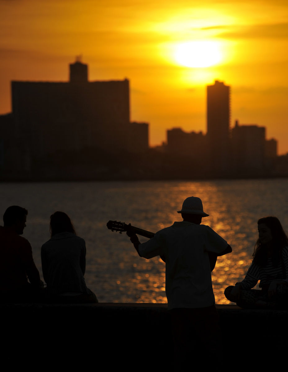 A man plays his guitar at sundown in Havana, Cuba.