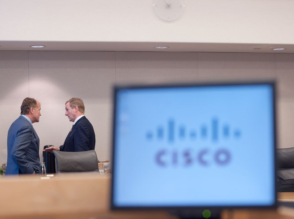 IRISH GOVERNMENT: Prime MInister of Ireland (R) speaks with Cisco CEO