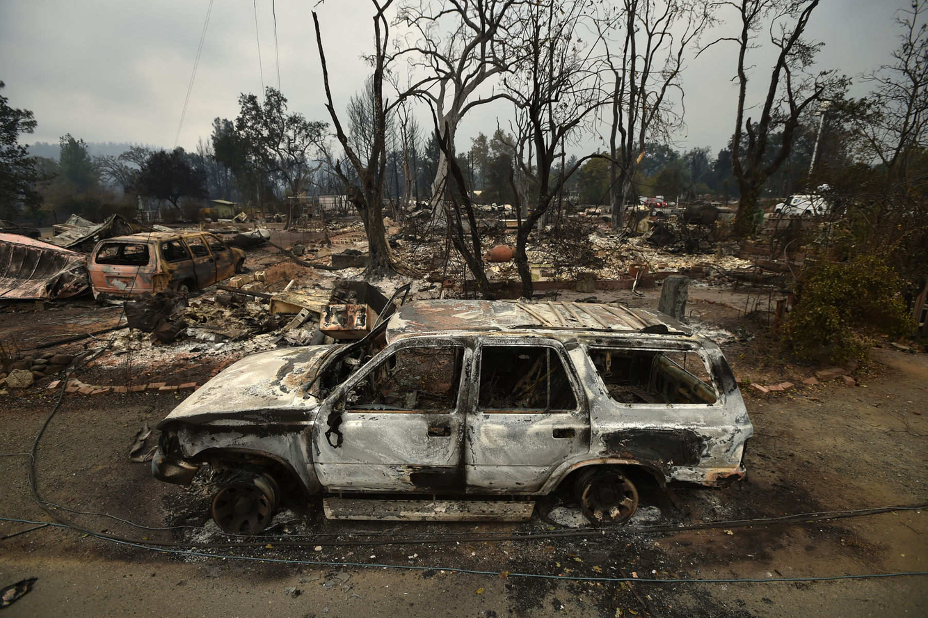 Burned out vehicles and homes are seen in a residential neighborhood of Middletown, California after the Valley fire tore through the area.