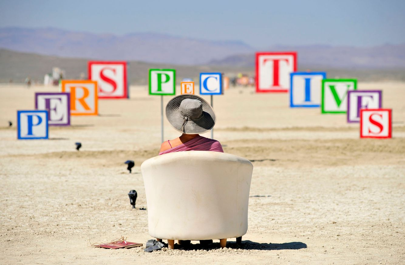 Kate Czark looks at an art installation from a strategic location at the Burning Man festival in Black Rock City, Nevada.