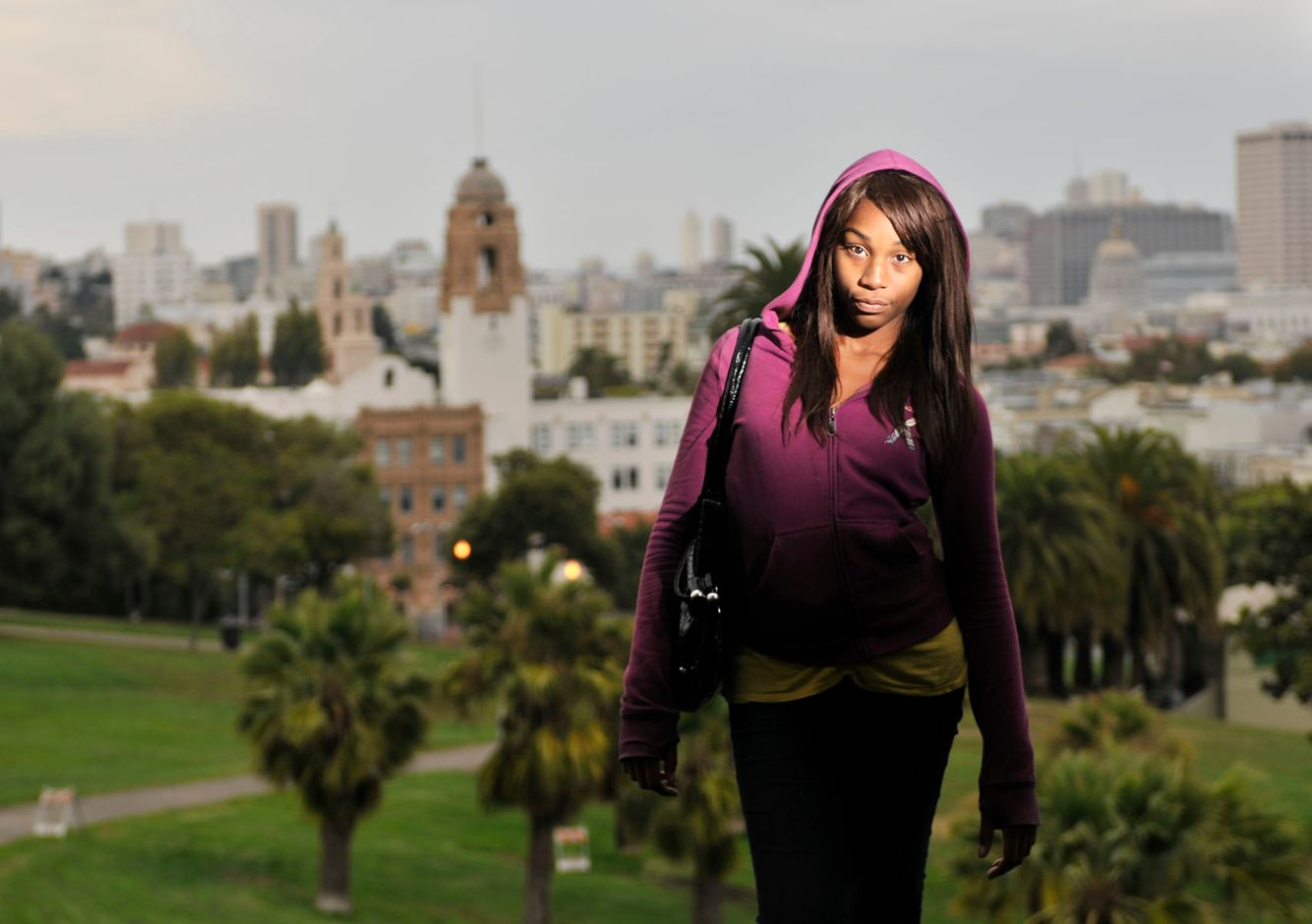 A transgender student victimized by bullying poses for a portrait near her San Francisco school.