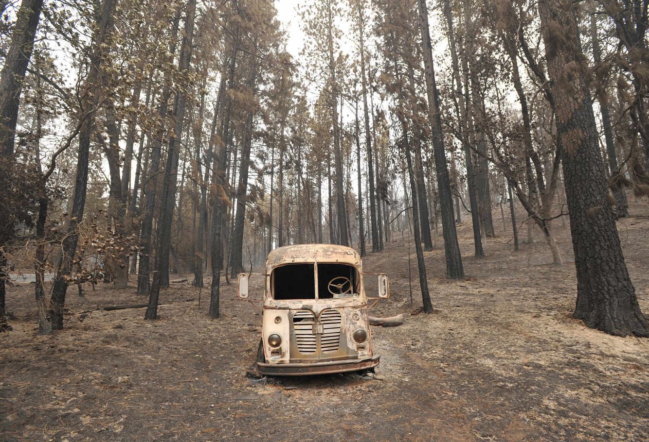 An abandoned burned out truck remains in a residential neighborhood after the Valley fire tore through the area.