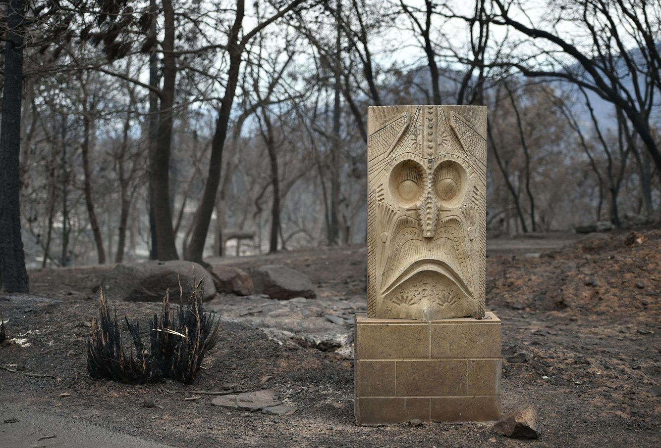 A stone statue is all that remains after the Valley fire tore through a residential neighborhood