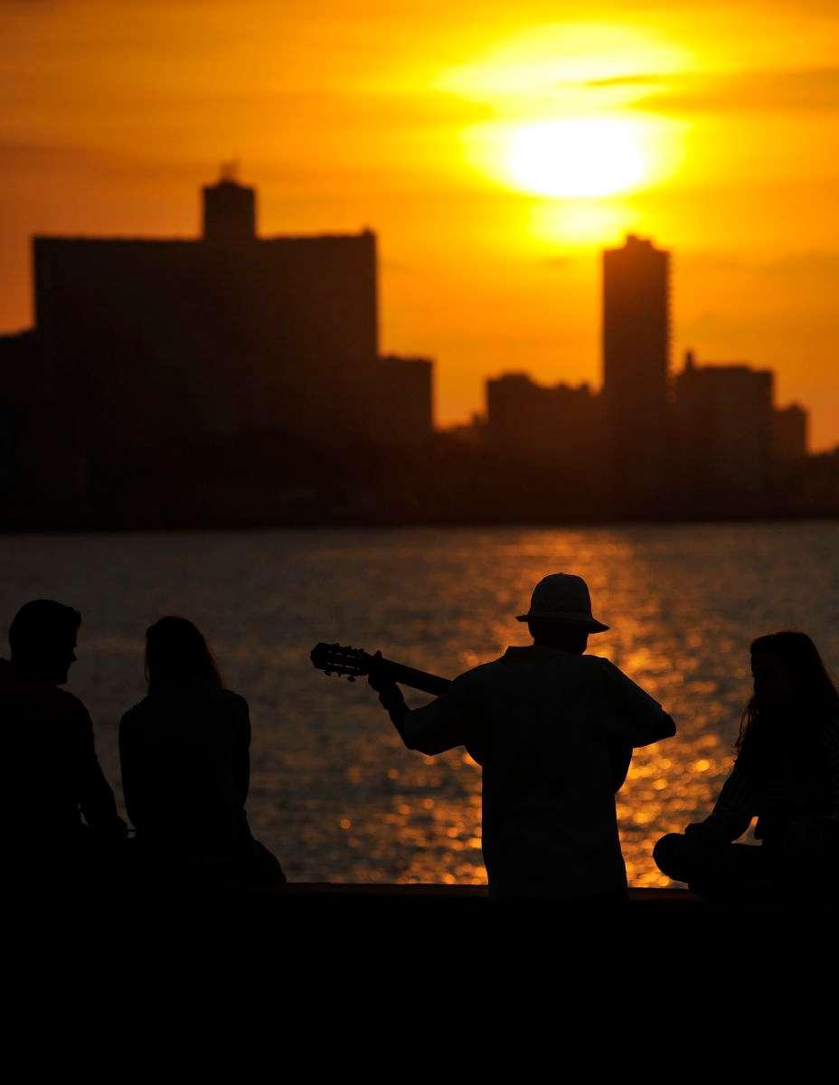 A man plays his guitar at sundown in Havana, Cuba.