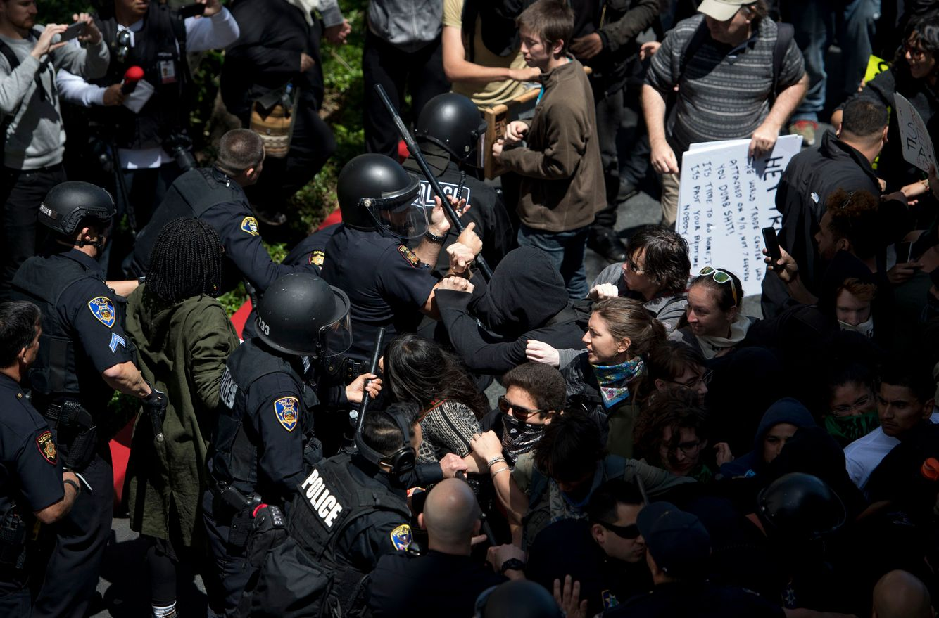 Anti-Trump protesters scuffle with police in San Francisco.