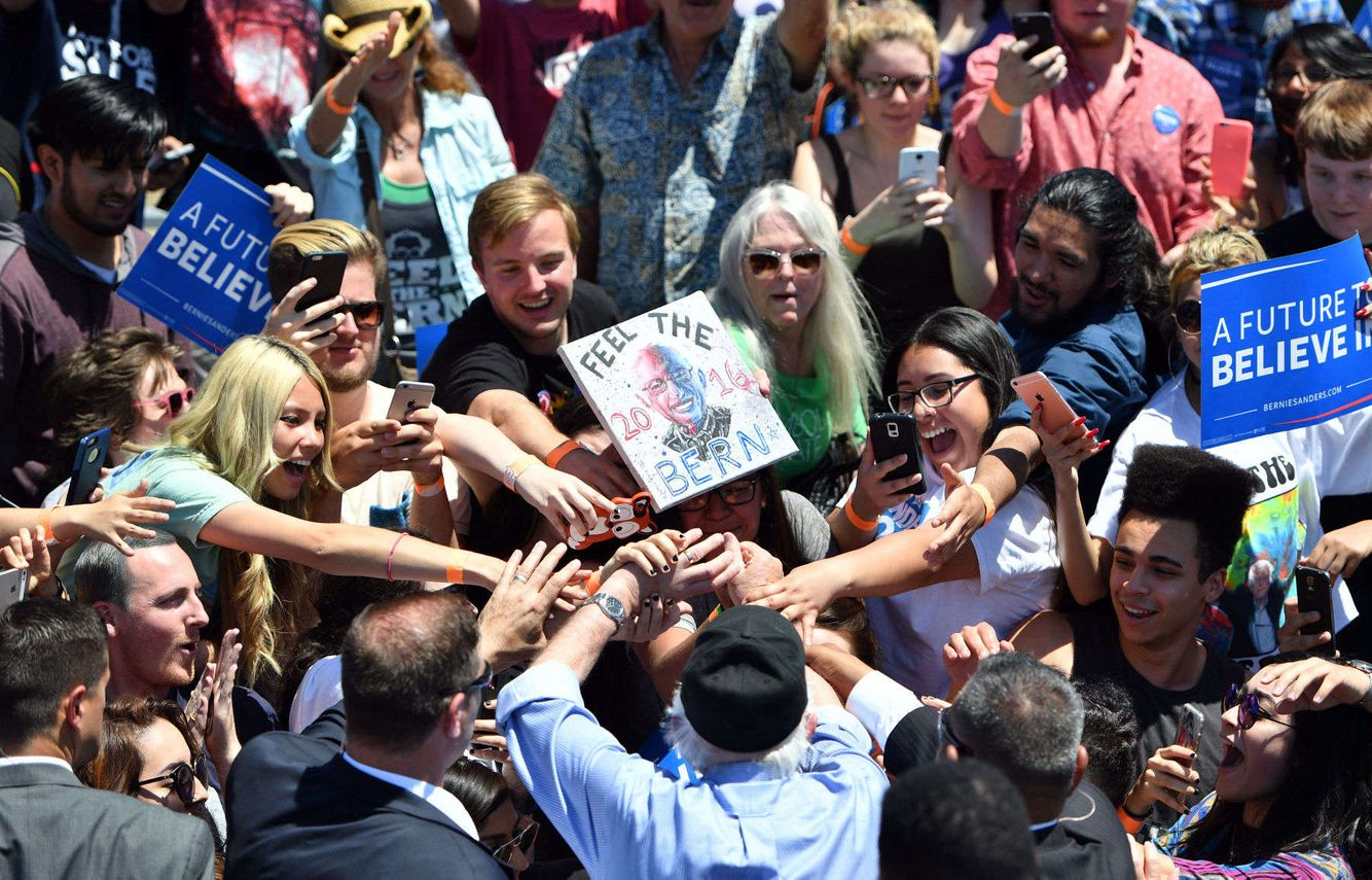 Supporters surround Bernie Sanders during a campaign event.