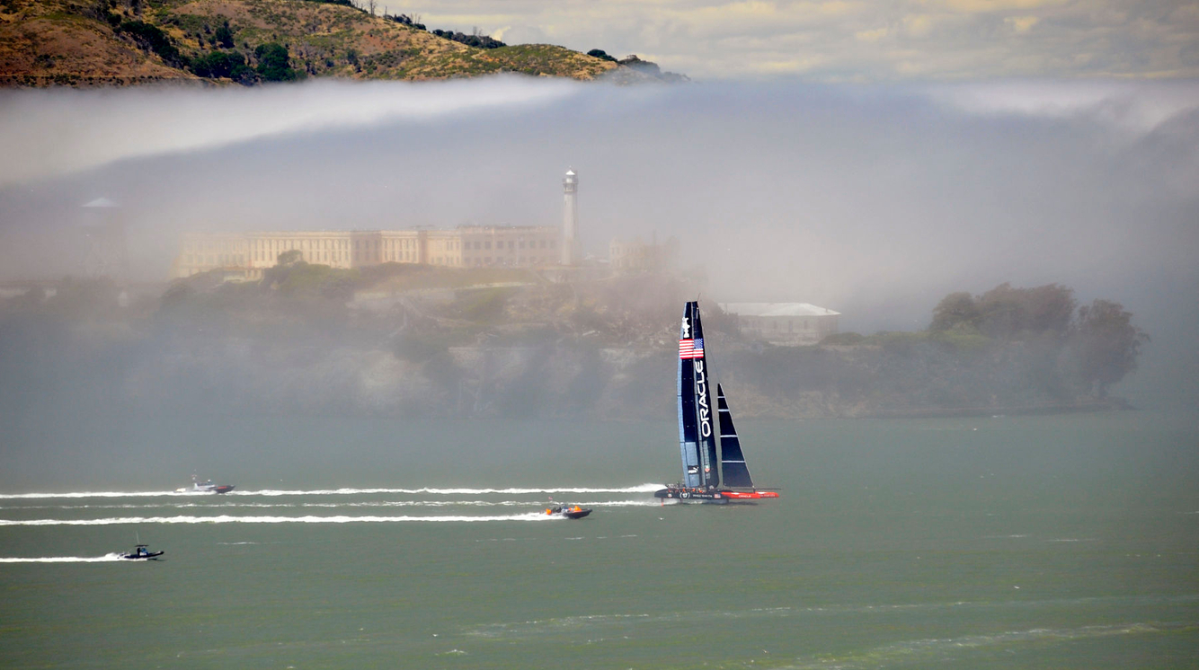 AMERICA'S CUP: Oracle Team USA sails their AC-72 Racing Yacht near Alcatraz before winning the tournament.