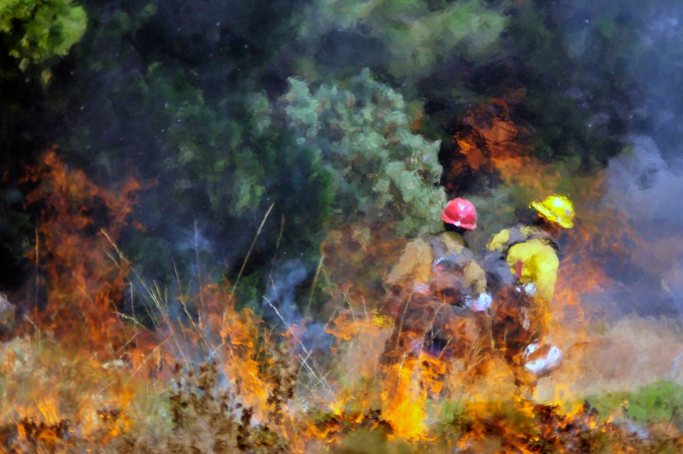 Firefighters are seen through heat