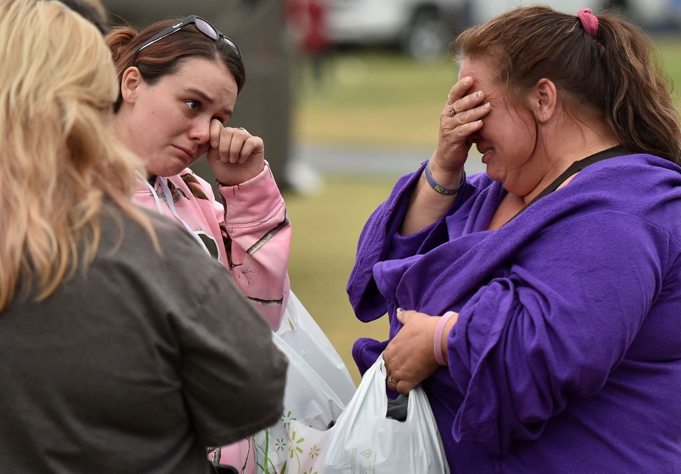 Evacuees mourn the loss of their home burned in the Valley Fire.