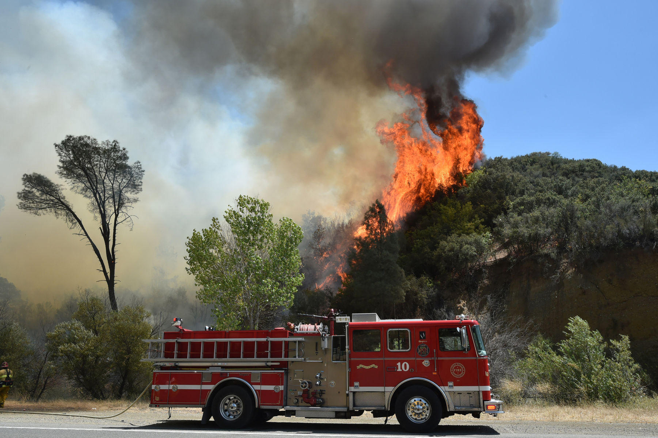Flames rise above a firetruck