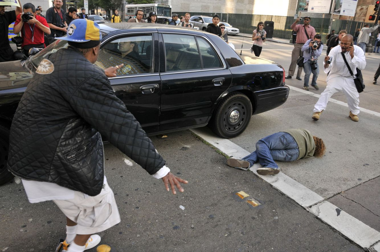 OCCUPY PROTEST: An Oakland Police vehicle backs over a deaf protester while retreating during an Occupy riot