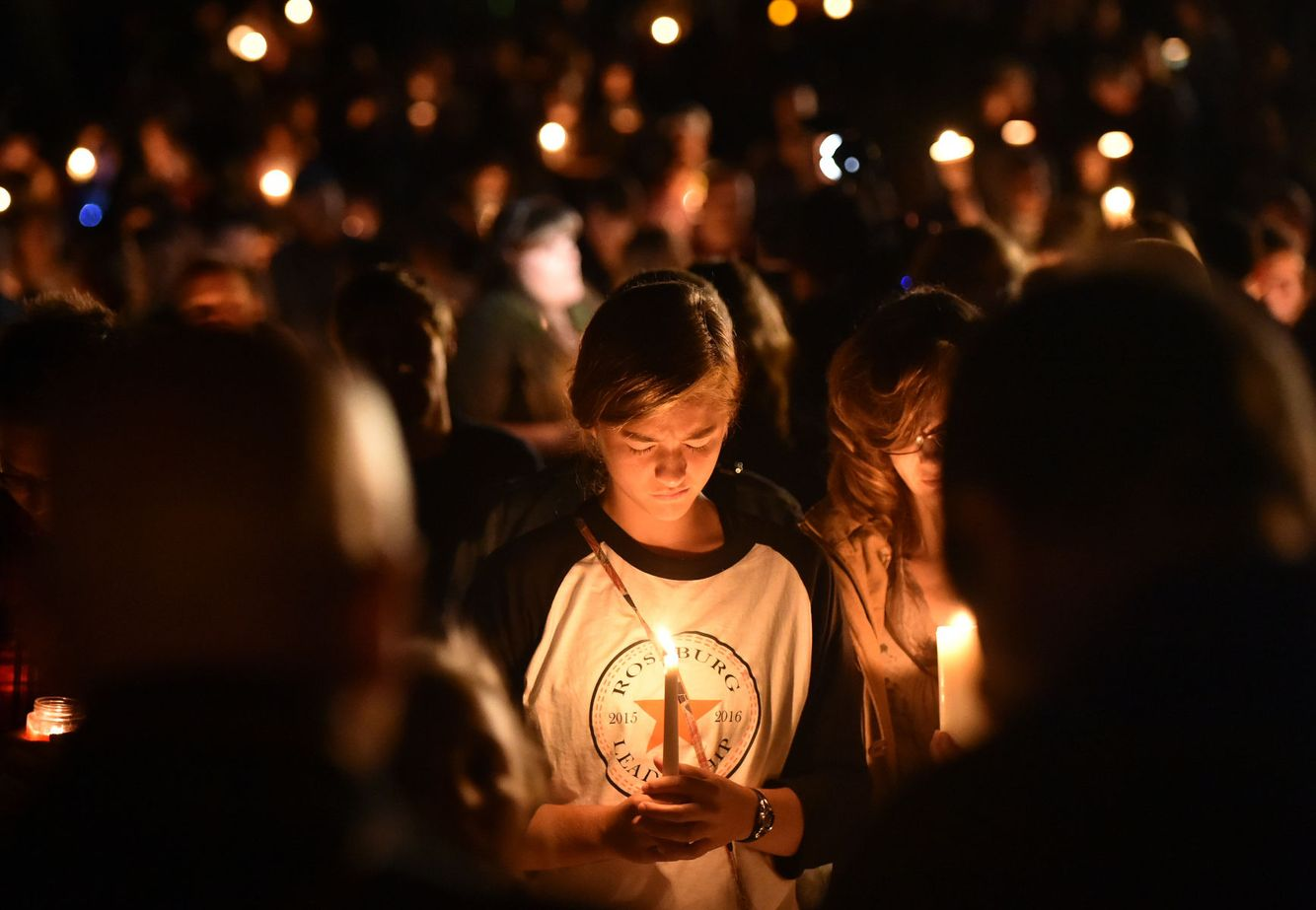 MASS SHOOTING: A girl weeps during a vigil for victims killed in Roseberg, Oregon
