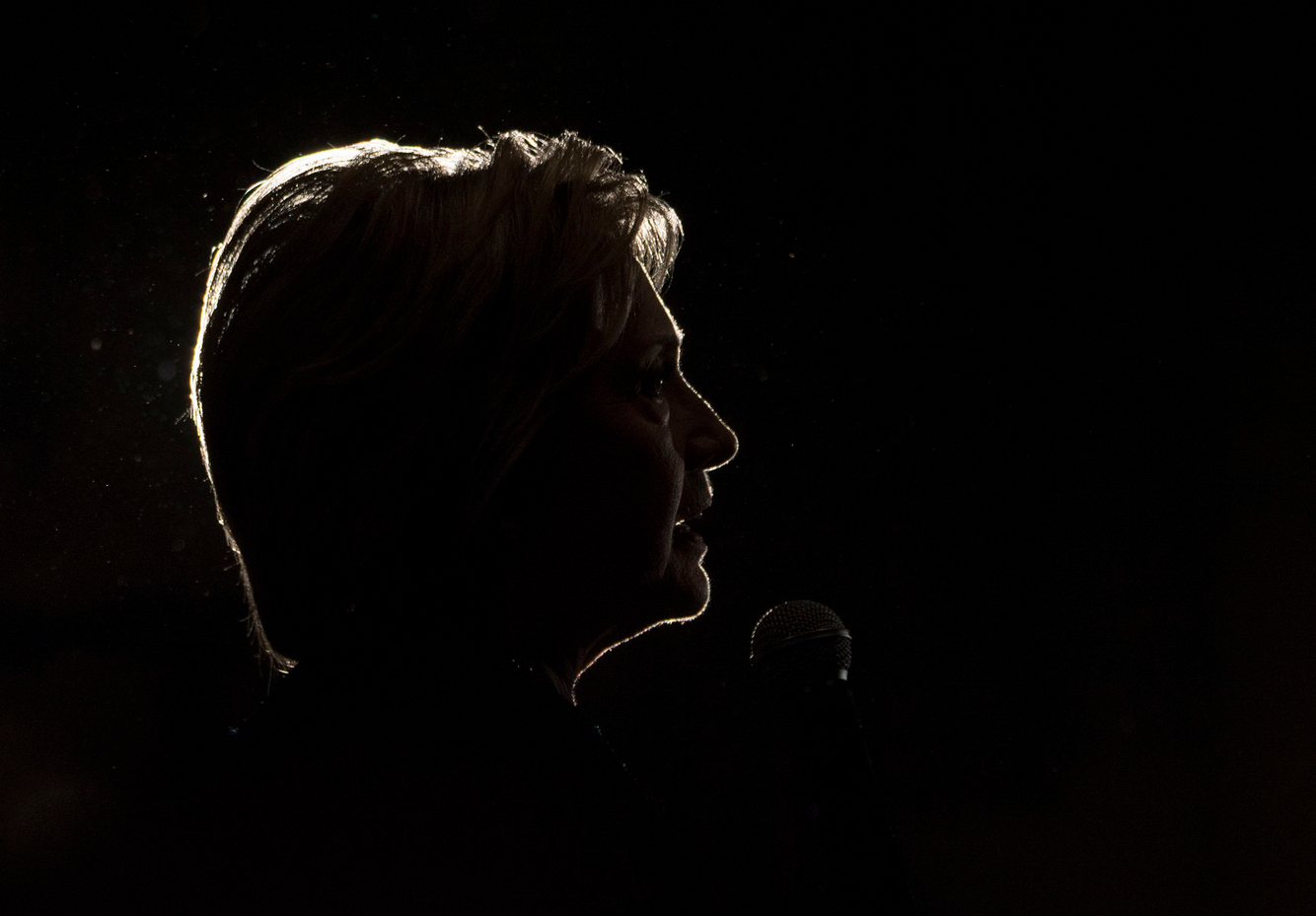 Hillary Clinton is silhouetted during a campaign event in Las Vegas.