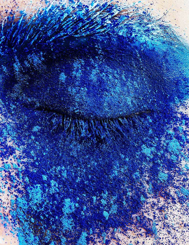 shades of blue pigments on a closed eye