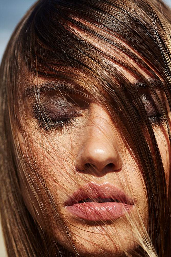 CLOSE UP  WITH HAIR IN FACE - BEACH BEAUTY