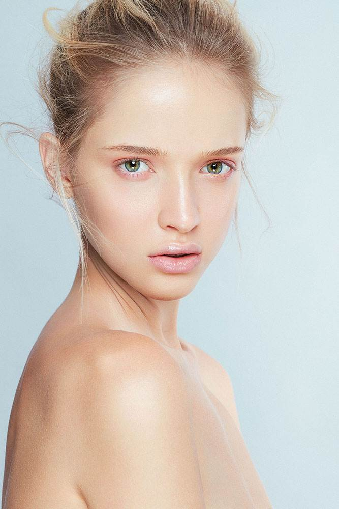 fresh clean beauty shot of a blond model with green eyes