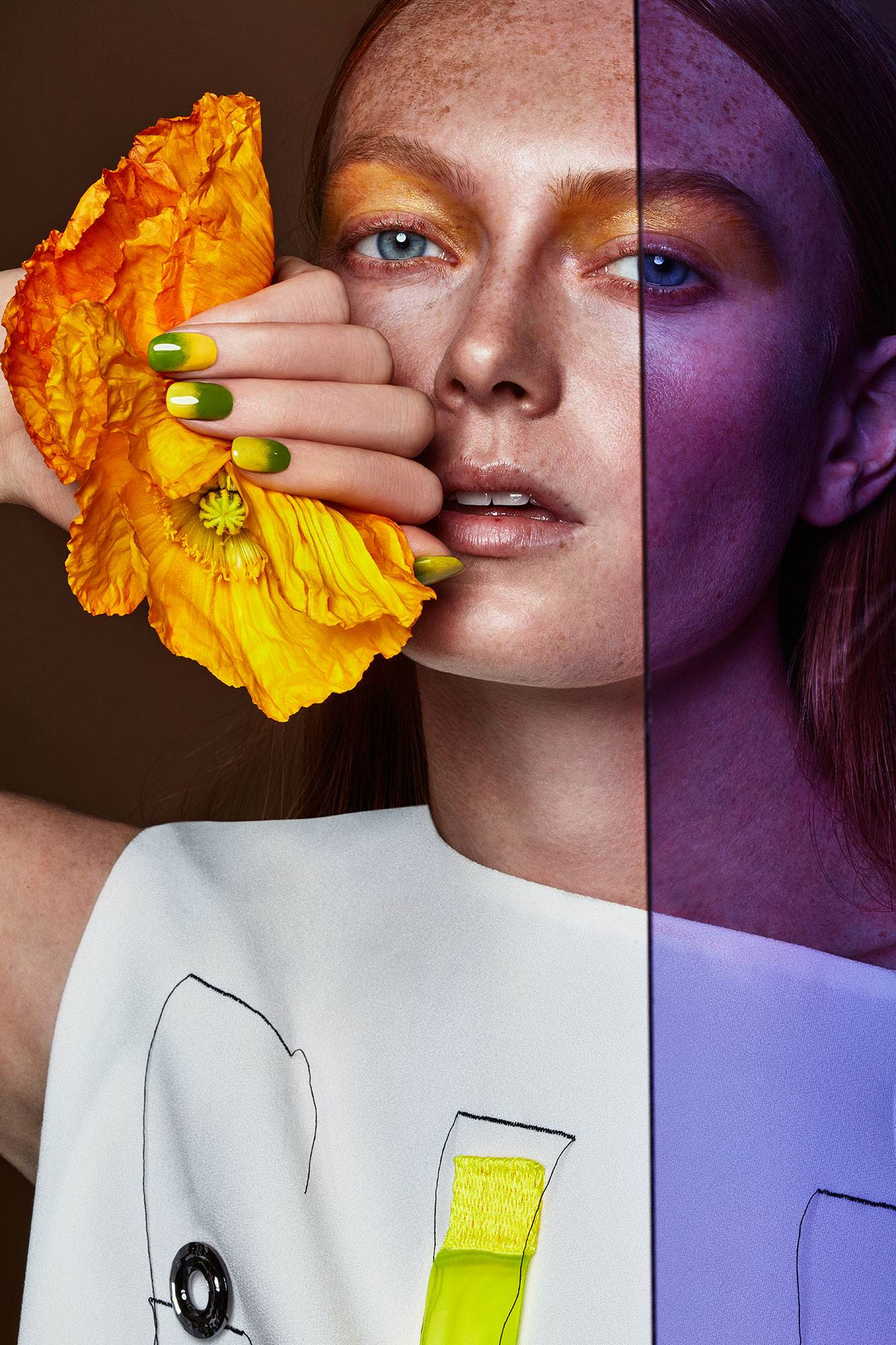 BEAUTY IMAGE WITH YELLOW/ORANGE POPPY IN THE HAND OF THE MODEL