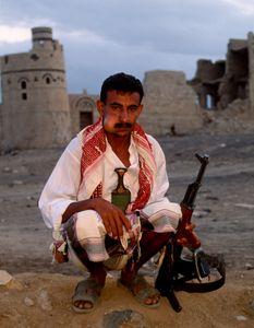 Gentleman with Jambiya, Rifle & Qat. Marib, Yemen