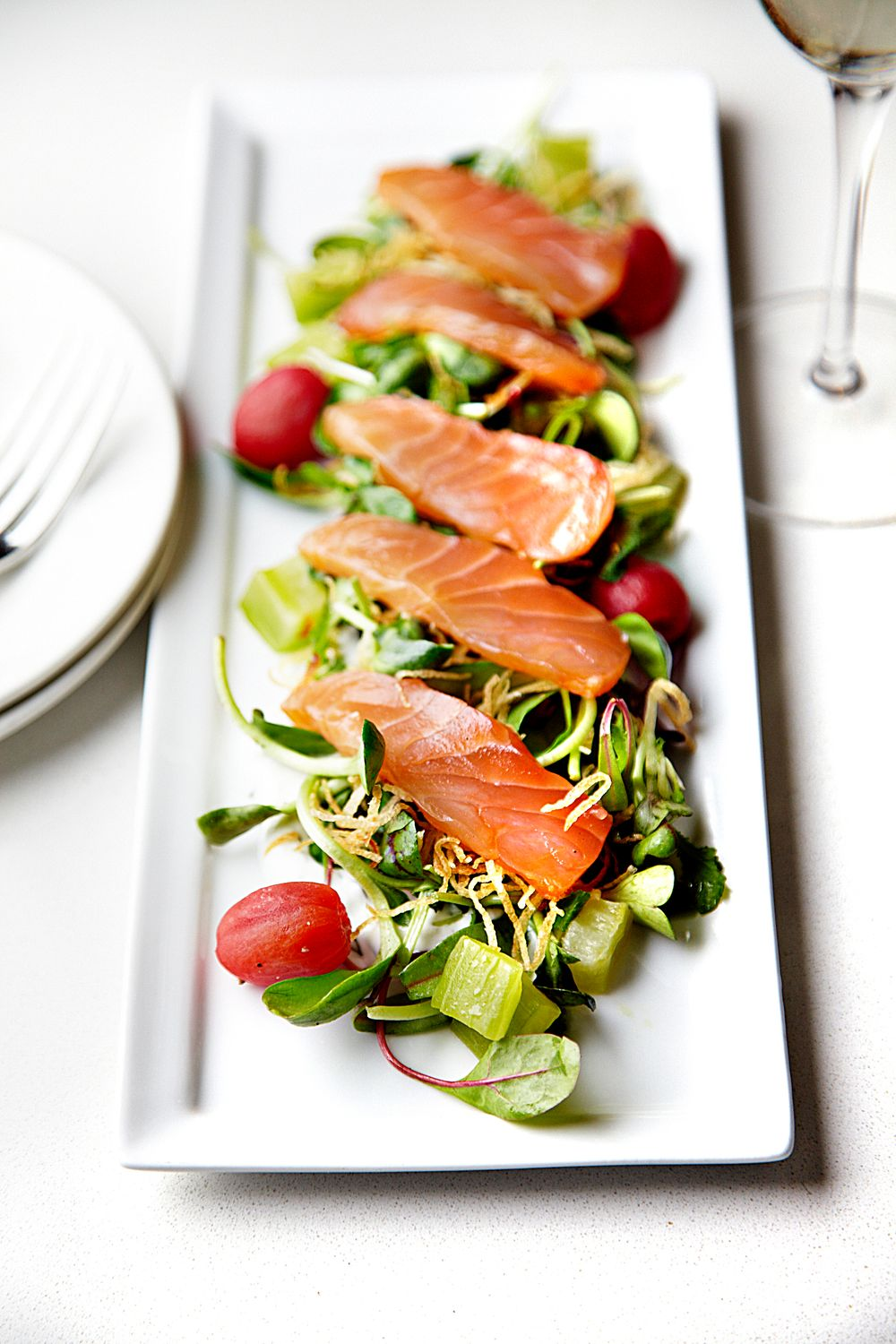 Gravlax in elegant restaurant setting.
