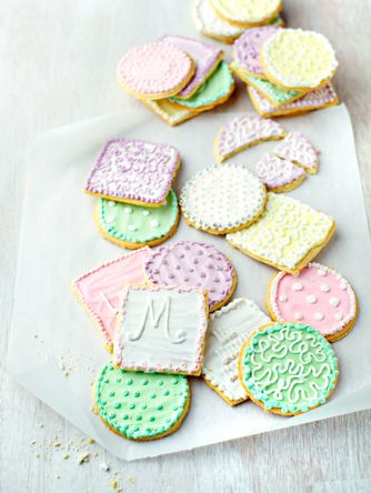 Elegant cookies on white wood background