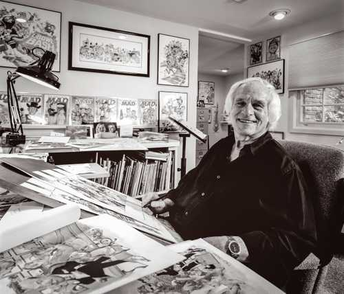 Amazing Cartoonist/caricaturist Mort Drucker photographed in his studio