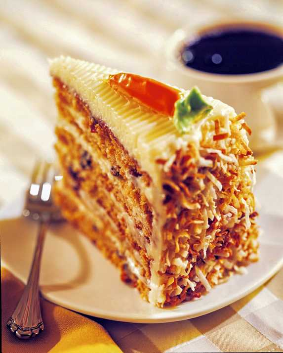 A nice slice of Carrot Cake and a cup of coffee photographed for Station Casinos