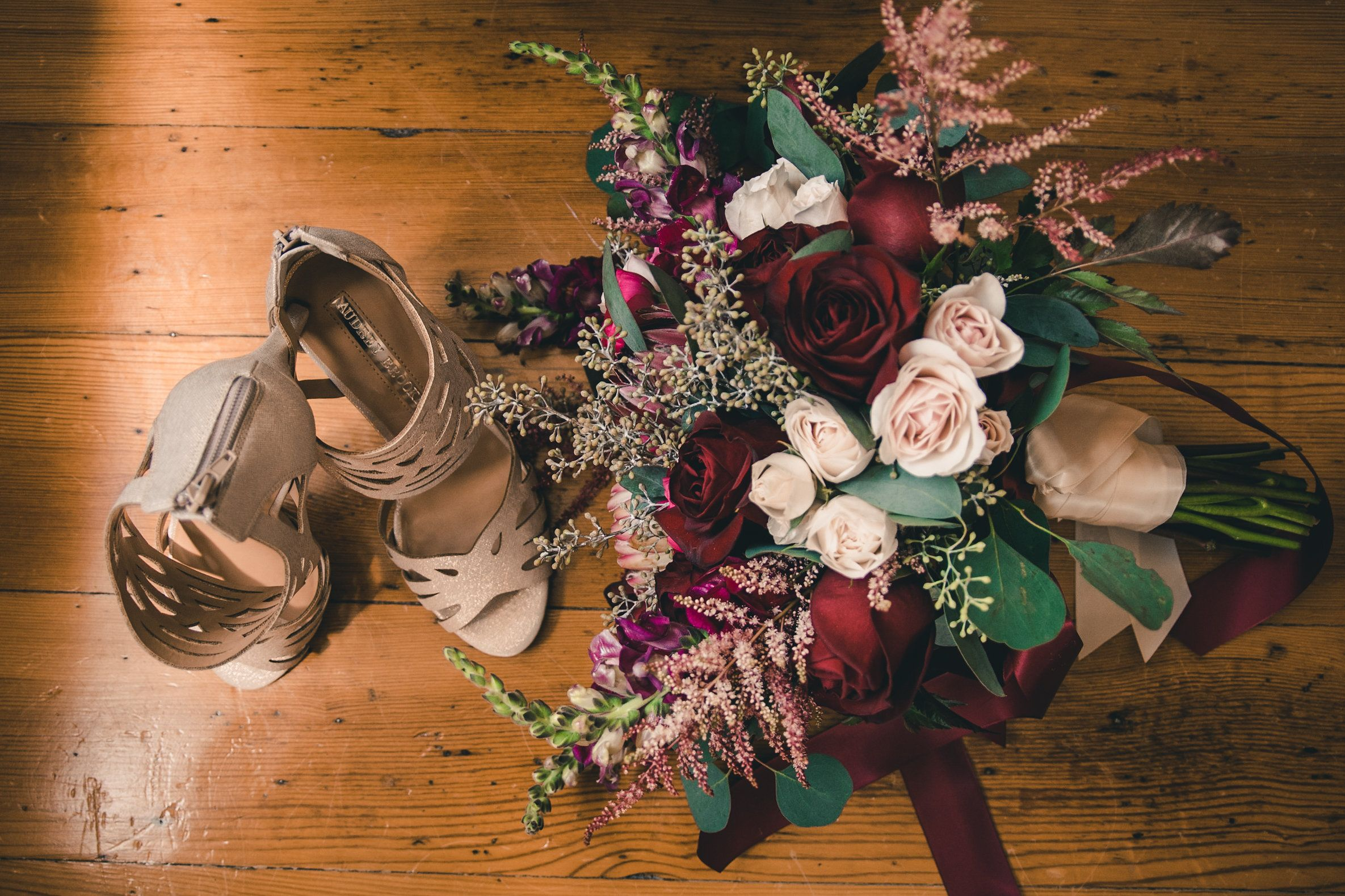 Bride's+shoes+and+flowers+seen+from+above.jpeg