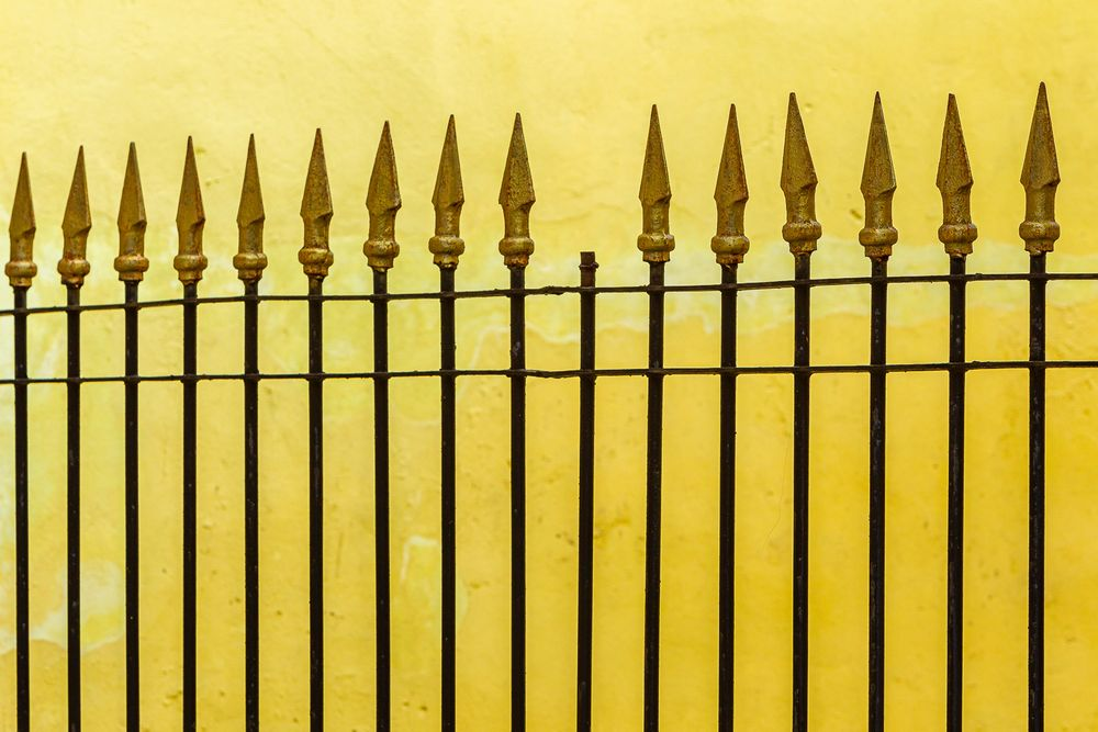 cuba_street_spear_fence_yellow_wall.jpg