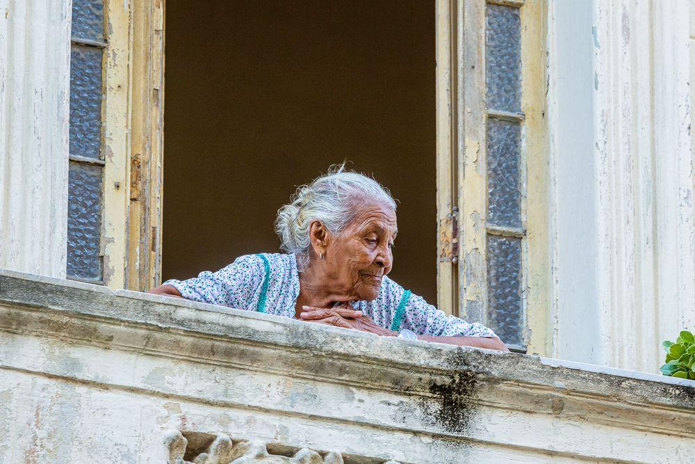 cuba_elderly_woman_procession_balcony.jpg