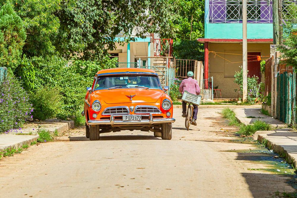 cuba_street_orange_car_striped_bike.jpg