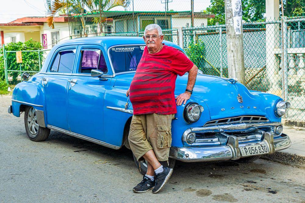 cuba_street_man_with_dodge_car.jpg