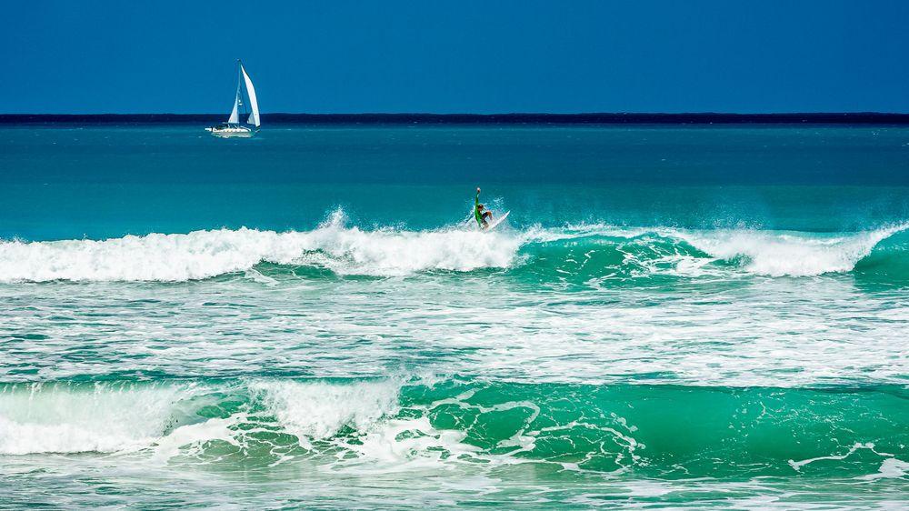 shoreline_surfer_sailboat.jpg