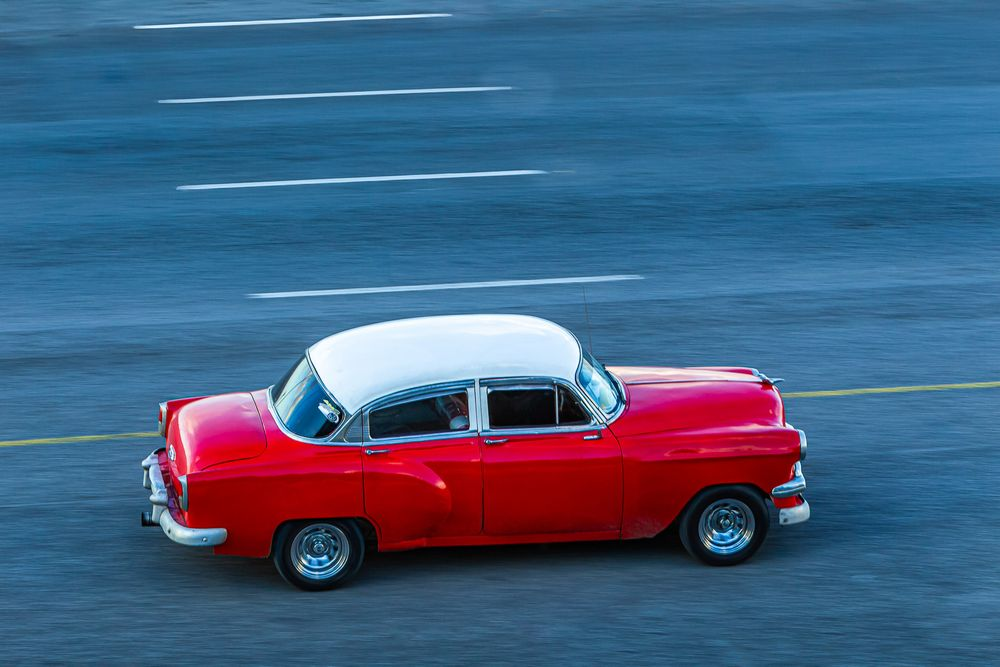 cuba_red_car_malecon.jpg