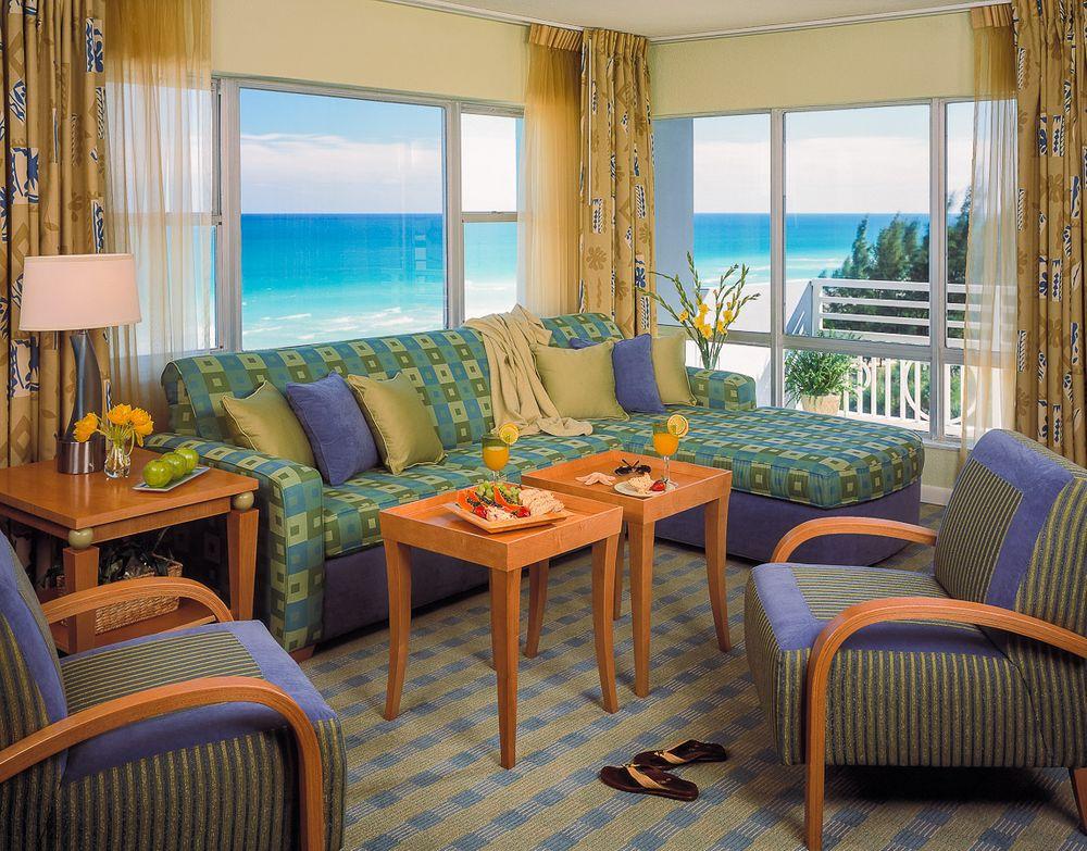1solara_resort_livingroom_oceanview.jpg