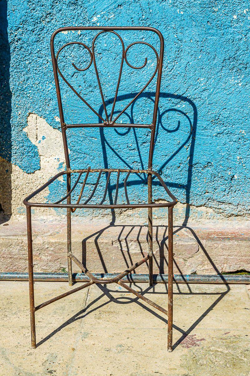 cuba_street_rod_iron_chair_blue_wall.jpg