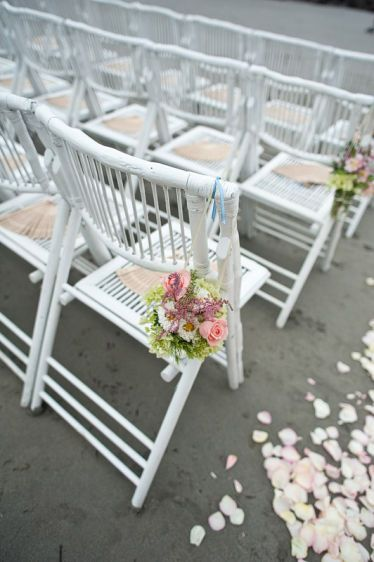 White folding wedding chairs
