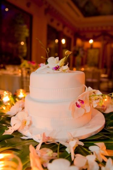 white cake with orchids