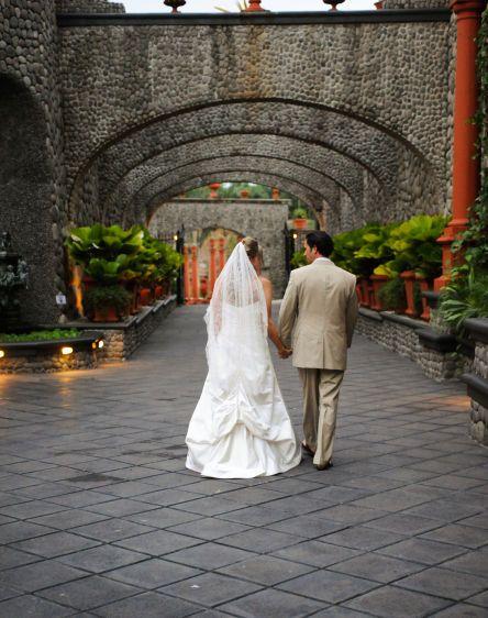 bride and groom walking Zephyr Palace