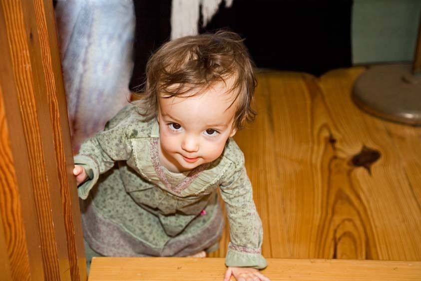 One year old Female baby begins to crawl up stairs