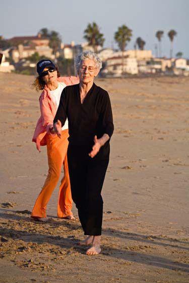 Senior women dance and exercise on beach