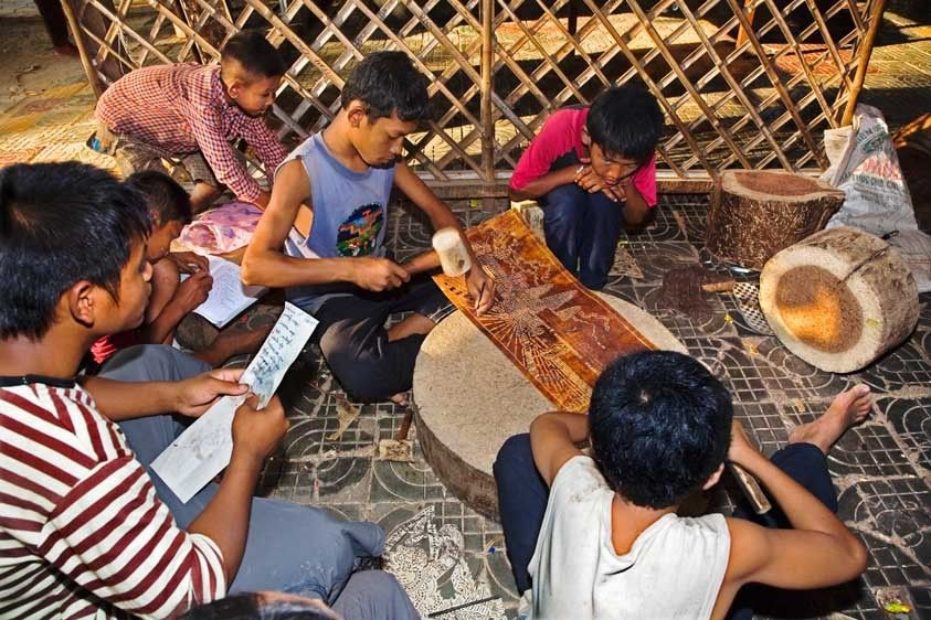Cambodian children study and work on art
