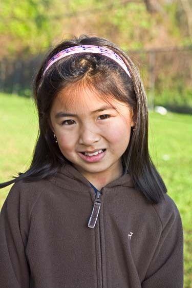 Seven year old Vietnamese-American female child headshot