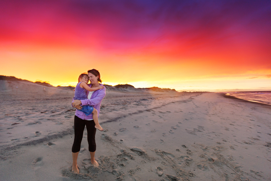 LifeStyle Image - Mom Holding Daughter on Beach at Sunset.jpg