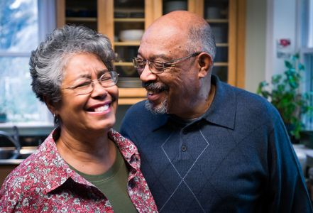 Happy African American Couple Displaying Affection.jpg