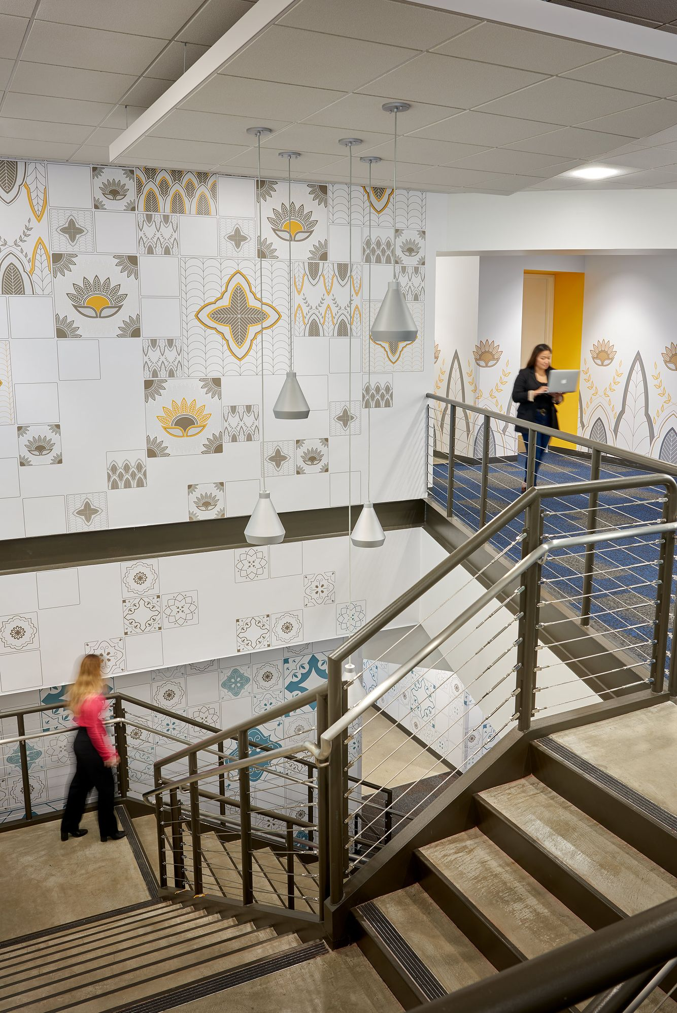stairway with graphics and working women