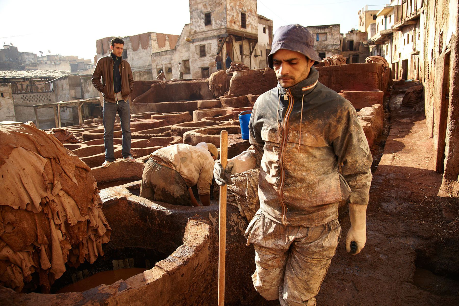Workers at a tannery in Fez, Morocco