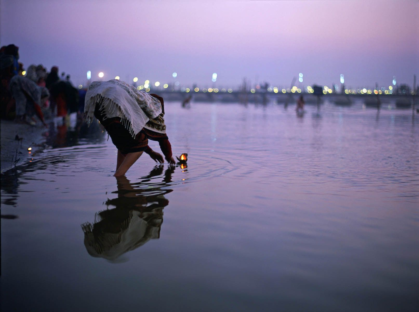 Puja at twilight on the Ganges River, Allahabad, India
