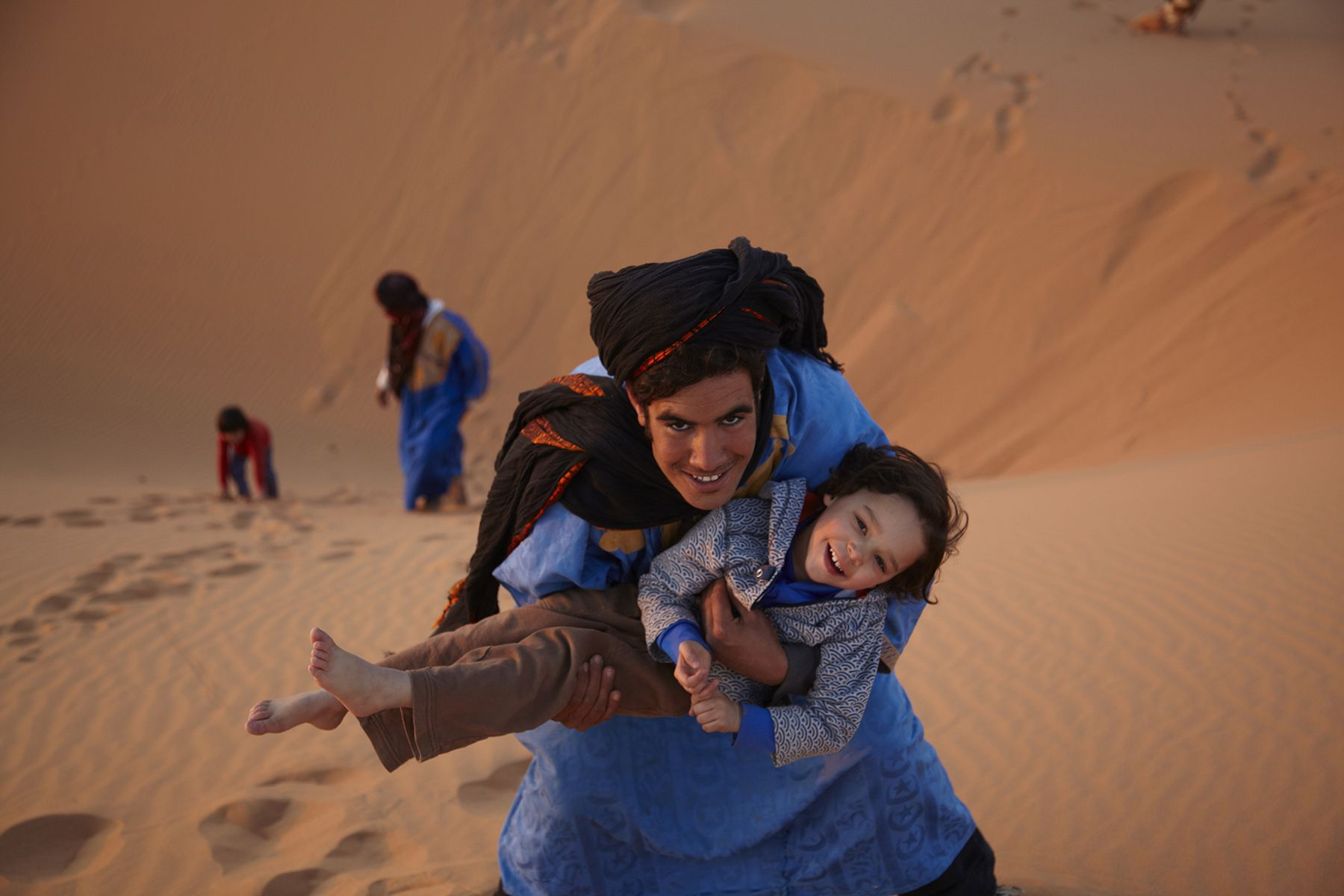 Playing in the dunes of Erg Chebbi, Morocco