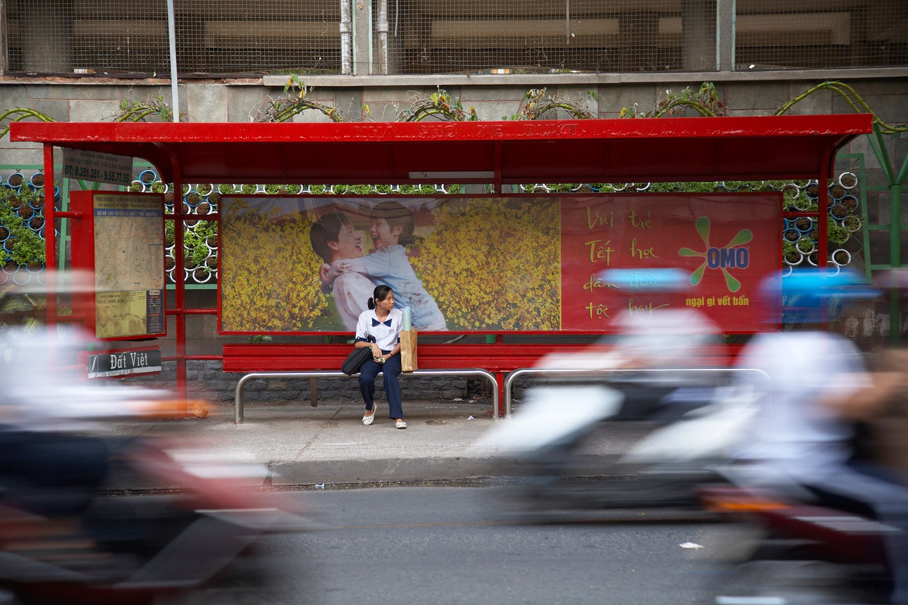Waiting for the bus in Ho Chi Minh City