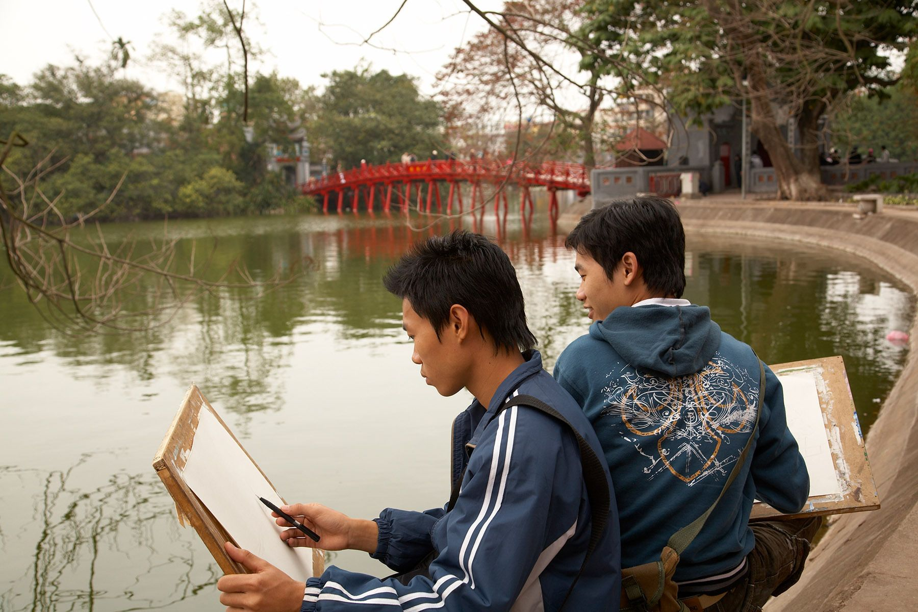 Art students sketching beside Hoan Kiem Lake, Hanoi